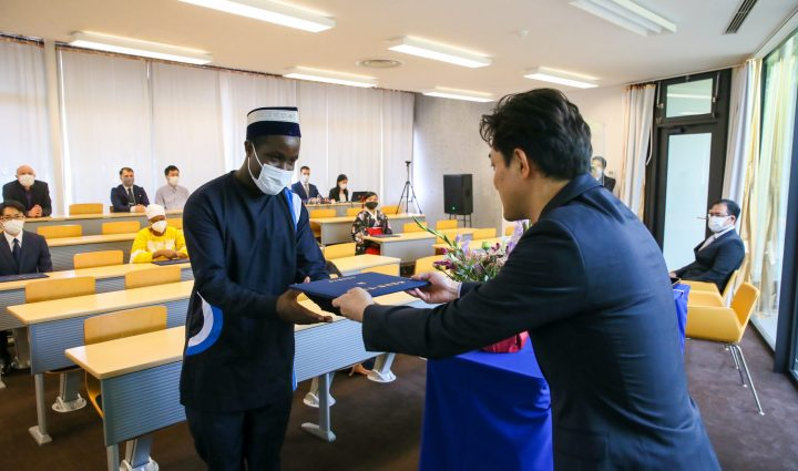 International student from Uganda receiving his diploma